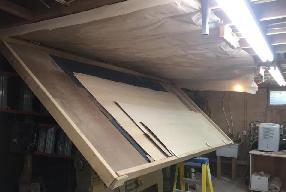 Ceiling-mounted veneer storage keeps supplies handy